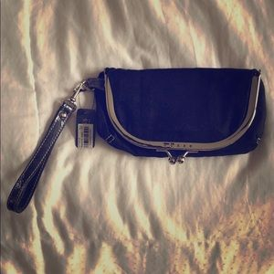 Black and silver GUESS clutch, NWT.